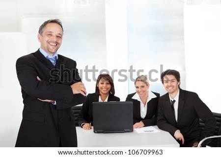 Portrait successful business man and his team