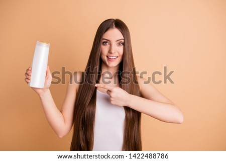 Portrait surprised astonished impressed charming teeth teenager hold hand have procedure content rejoice sign wow omg unbelievable unexpected stylish trendy white top singlet beige background