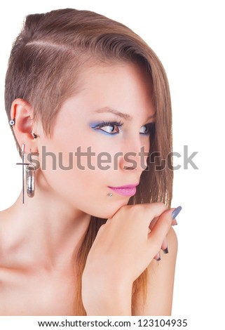 Portrait teen girl with face piercings isolated on white background