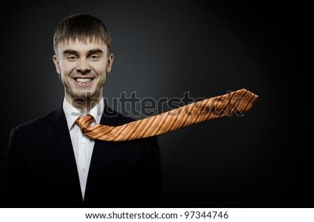 portrait  the  beautiful  businessman careerist in black costume and orange necktie