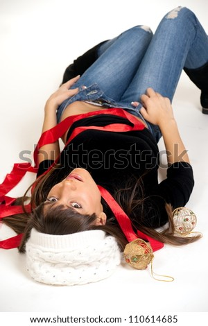 Portrait to beautiful sexual girl in hat on white background with new year's toy