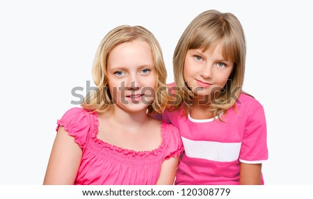 Two Girls On White Background Portrait