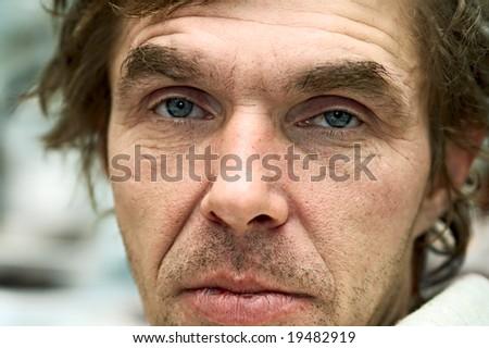 portrait unshaven drunk men