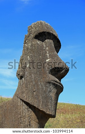 Portrait view of an ancient moai sculpture on Easter Island