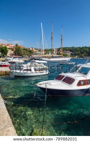 Portrait view of boats harbored in Cavtat, Croatia.