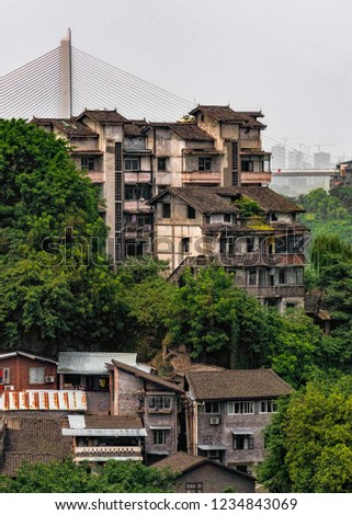 Portrait View of Historic Apartment Buildings in Chinese City. Hillside Housing with View of Bridge in Distance (Chongqing, China).
