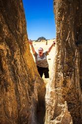 Portrait view of mature woman tourist admiring the limestone pinnacles in the Nambung National Park, Cervantes, Western Australia.