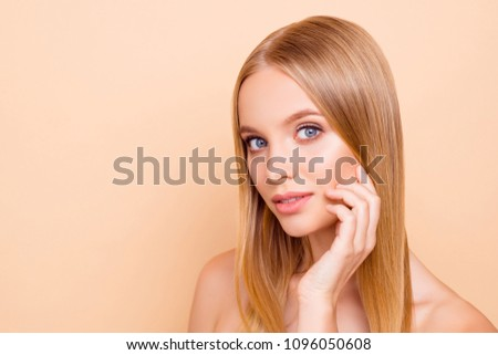 Portrait with copy space empty place of cute lovely charming gorgeous nude natural girl with flawless skin isolated on beige background, correction, moisturizing, hydration concept