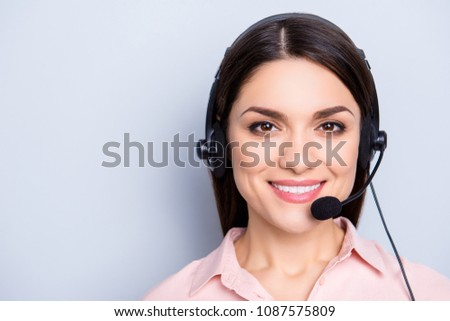 Portrait with copy space of cheerful positive cute woman in shirt with headset and microphone on her head looking at camera isolated on grey background advertisement concept #1087575809