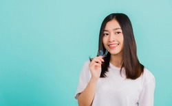 Portrait young Asian beautiful woman smiling holding silicone orthodontic retainers for teeth, Teeth retaining tools after removable braces, Orthodontics dental healthy care concept
