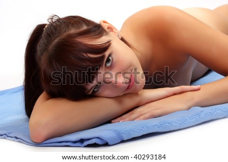 Portrait young attractive girl lying on blue towel