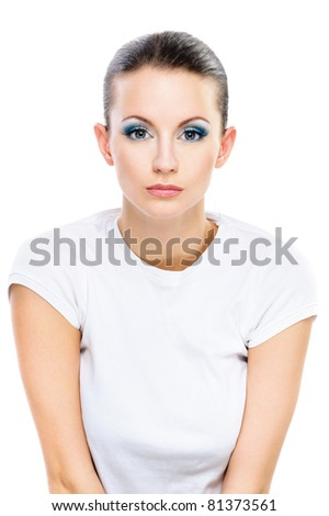 Portrait young beautiful serious dark-haired woman in white T-shirt, isolated on white background.