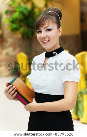 portrait young brunette room books hand