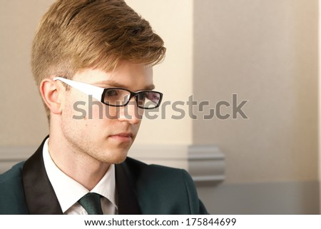 Portrait young handsome stylish man fashion model inside in cafe