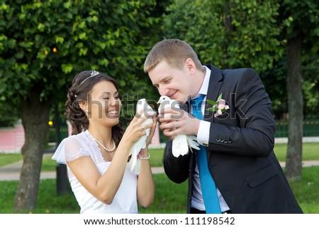 Portrait young happy bride and groom outdoor