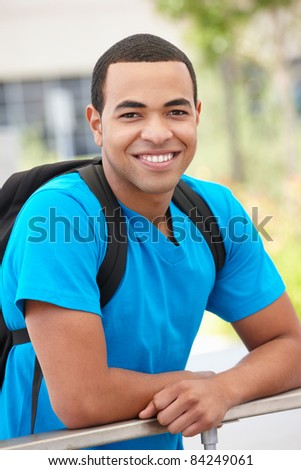 Portrait young man outdoors - stock photo