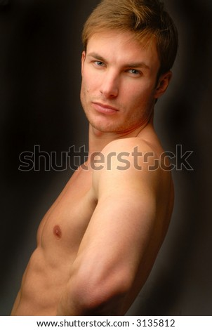 stock photo : portrait young naked men which looks the chamber on dark ...