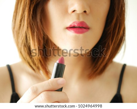 portrait young woman applying or wearing lipstick, red ,pink ,make up and cosmetic .isolated white background. cosmetic beauty concept #1024964998