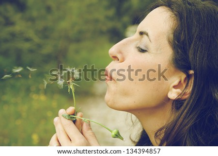 portrait young woman with dandelion