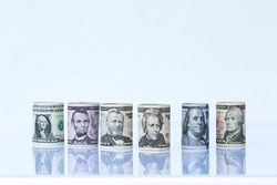 Portraits of America presidents and politicians from dollars  on white background. This has clipping path.