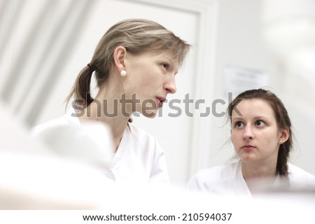 Portraits of health care workers having conversation in clinic