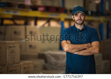 Portraits of male warehouse personnel staff wearing blue uniforms Currently working in storage and transportation internationally. Stock photo ©