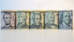 Portraits of the Presidents on rolls banknotes, Money or Portraits of Presidents, Close up portraits of the dollar bills on white background, Close up portraits of rolls dollar banknotes