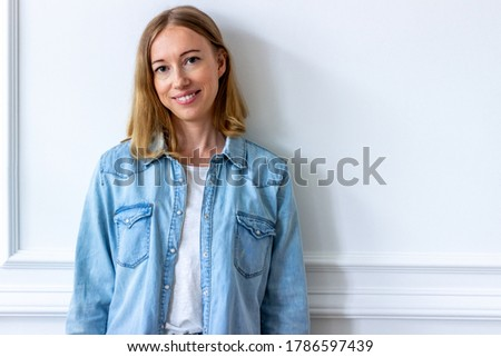 Portret of young blond woman at home Stockfoto ©