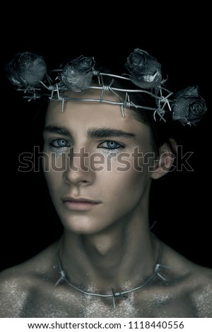 Portrete of fashion young man in the image of a martyr