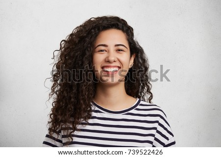 portriat of pretty curly female ...