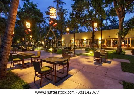 portrtait of beautiful outdoor and indoor restaurant view in night illumination