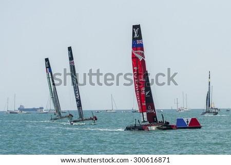PORTSMOUTH, UK - JULY 25: The Team Emirates, Land Rover BAR, and Groupama America\'s Cup boats sailing in the America\'s Cup World Series in Portsmouth shown on July 25, 2015 in Portsmouth, UK