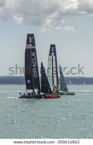 PORTSMOUTH, UK - JULY 25: The Team Oracle and Groupama America\'s Cup boats sailing in the America\'s Cup World Series qualifiers in Portsmouth shown on July 25, 2015 in Portsmouth, UK