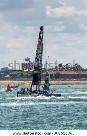 PORTSMOUTH, UK - JULY 25: The UK Team Land Rover BAR America\'s Cup boat sailing in the America\'s Cup World Series qualifiers in Portsmouth shown on July 25, 2015 in Portsmouth, UK