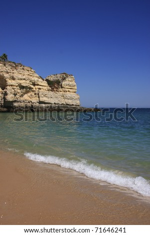 Portugal Algarve beautiful deserted golden sandy beach sheltered by high cliffs