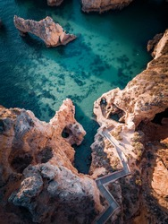 Portugal, Algarve. Cliffs, coastline and ocean from above, stairway to the sea