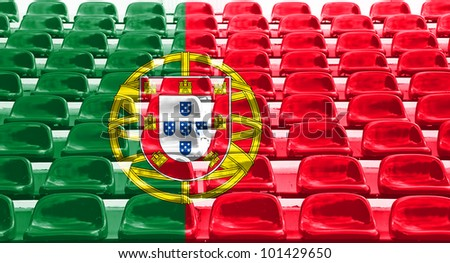 Portugal flag pattern on seats at outdoor sport stadium.