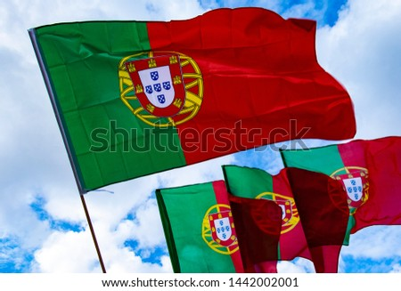 Portugal Flags Against a Cloudy Blue Sky #1442002001