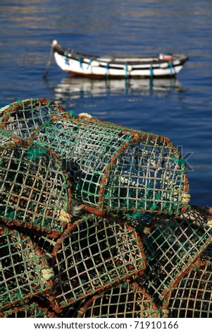Portugal Lisbon's Sunshine Coast Bay of Cascais - fishing traps with typical coastal fishing boat in background
