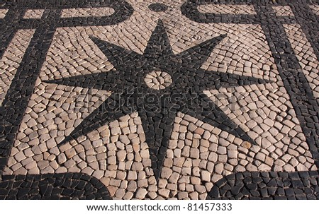 "Portugal Lisbon Typical old  Portuguese black and white mosaic ""calcada"" pavement"