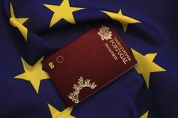 Portugal passport with European Union flag in background