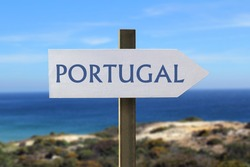 Portugal sign with seaside in the background
