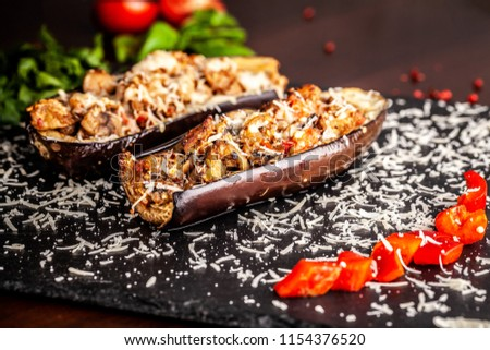 Portuguese cuisine. Baked eggplants with mushrooms, meat, vegetables and parmesan cheese. Copy space, selective focus #1154376520