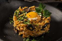 Portuguese cuisine - Frango a Bras. Traditional Portuguese dishes, based on sautéed chicken with onion, garlic, parsley, olives, egg and potatoes chips. A variation of the traditional Bras cod dish