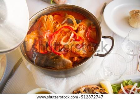 portuguese dish caldeirada in iron pot