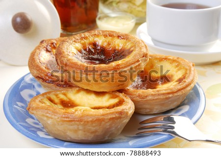 Portuguese  egg  tart  on dish on restaurant table
