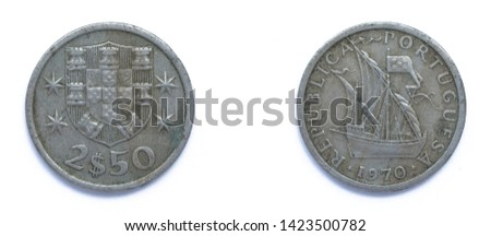 Portuguese 2.5 Escudo copper-nickel coin 1970 year. The coin shows Coat of Arms of Portugal and Carrack, ocean-going sailing ship that was developed in the 14th to 15th centuries in Europe, Portugal.