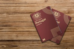 Portuguese passports are issued to citizens of Portugal for the purpose of international travel ,Portugal passport on a wooden background