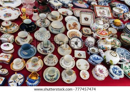Portuguese porcelain souvenirs on a local flea market in Lisbon #777457474