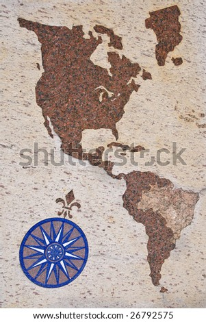 Portuguese style wind rose and map of Americas - mosaic on granite floor